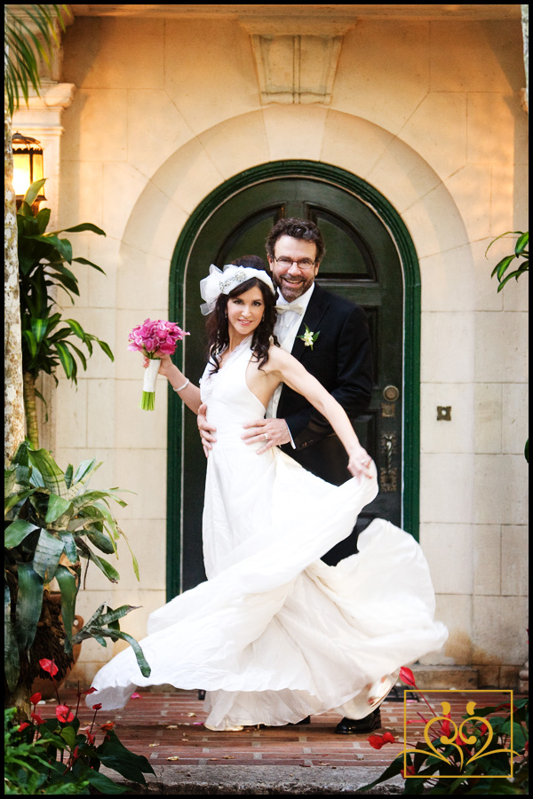 Jackaline & Don in a moving formal portrait in the entry way to Villa Woodbine.