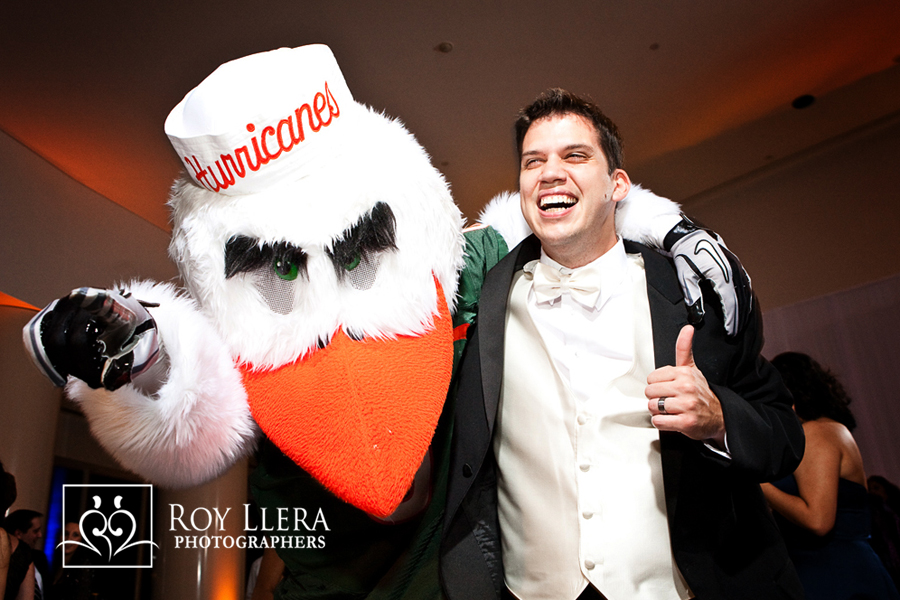Miami Wedding Groom with Universitry of Miami Mascot Sebastian The Ibis
